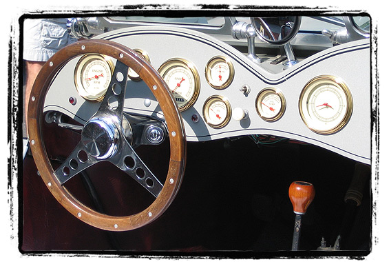 Dashboard of the Jaguar -- notice the real wood steering wheel.
